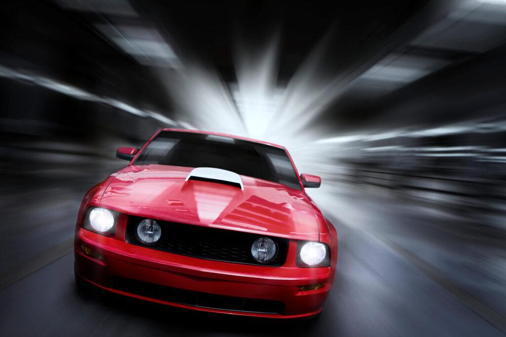 speeding red car