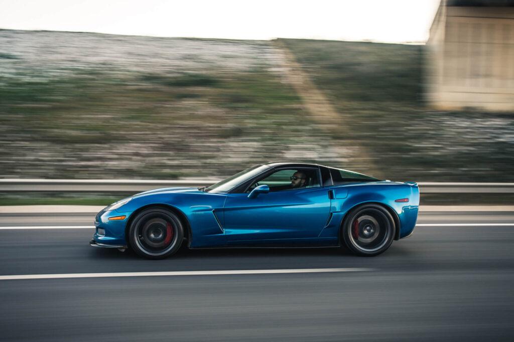 blue sports car speeding along
