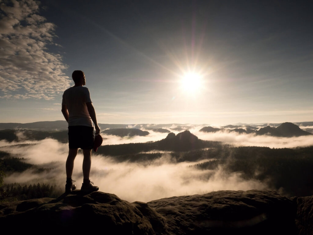 Rise Local Case Studies - Man on mountain looking out